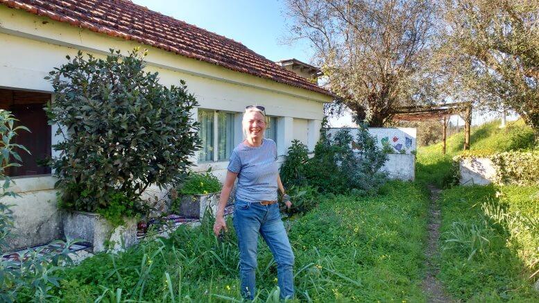 a-woman-pruning-the-laurel-in-the-Butterfly-Garden-of-Termas-da-Azenha